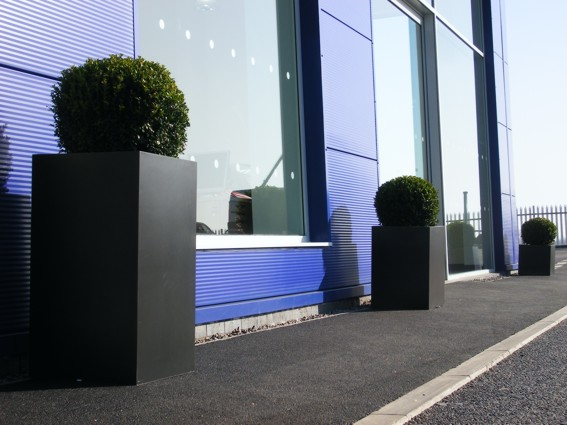 stone look exterior planters with buxus